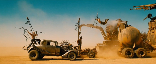 A stuntman leaps from vehicle to vehicle in 'Mad Max: Fury Road.'